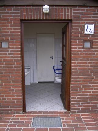Open door to an accessible toilett